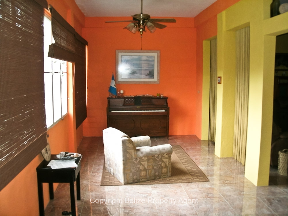 Sun room increases value of Belize real estate