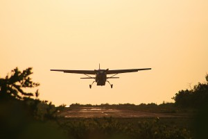 small plane landing at Dangriga Air Strip